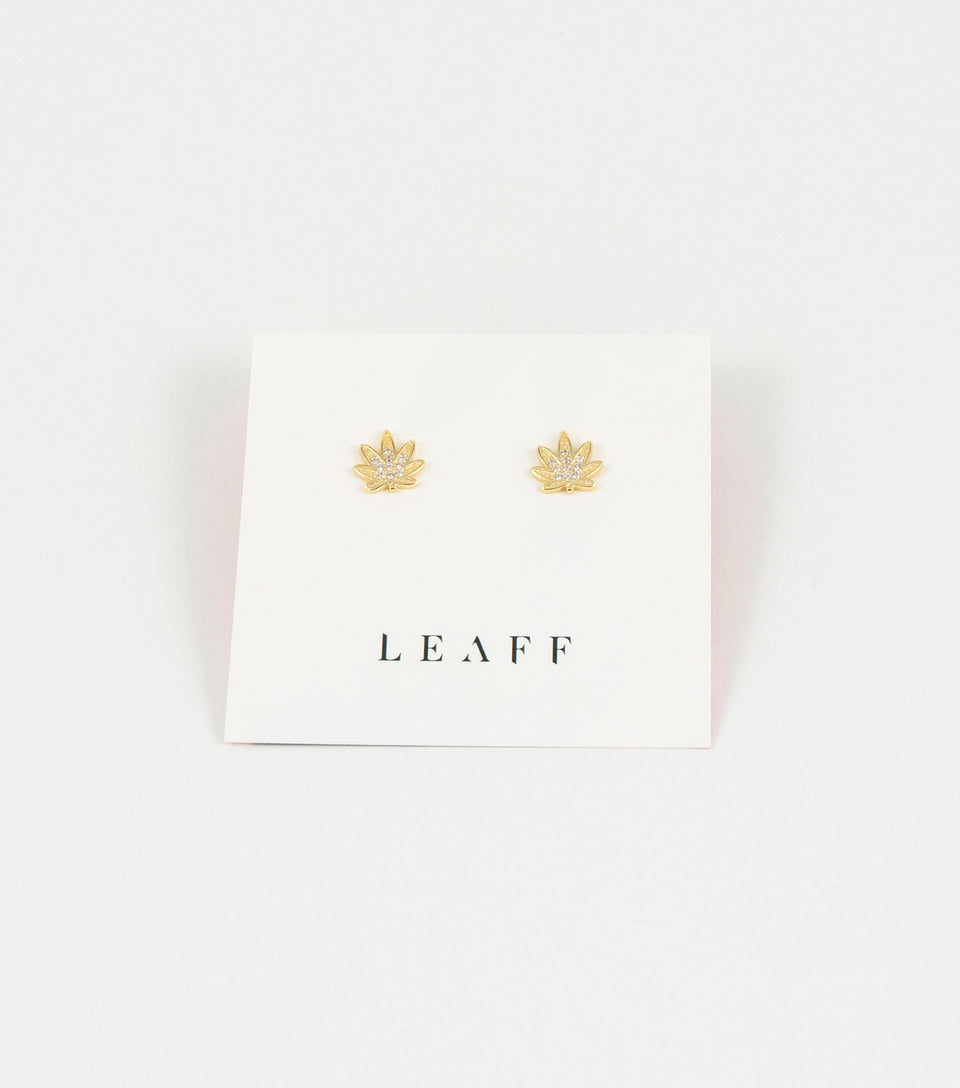 Pair of gold pot leaf earrings with cubic zirconia jewels.