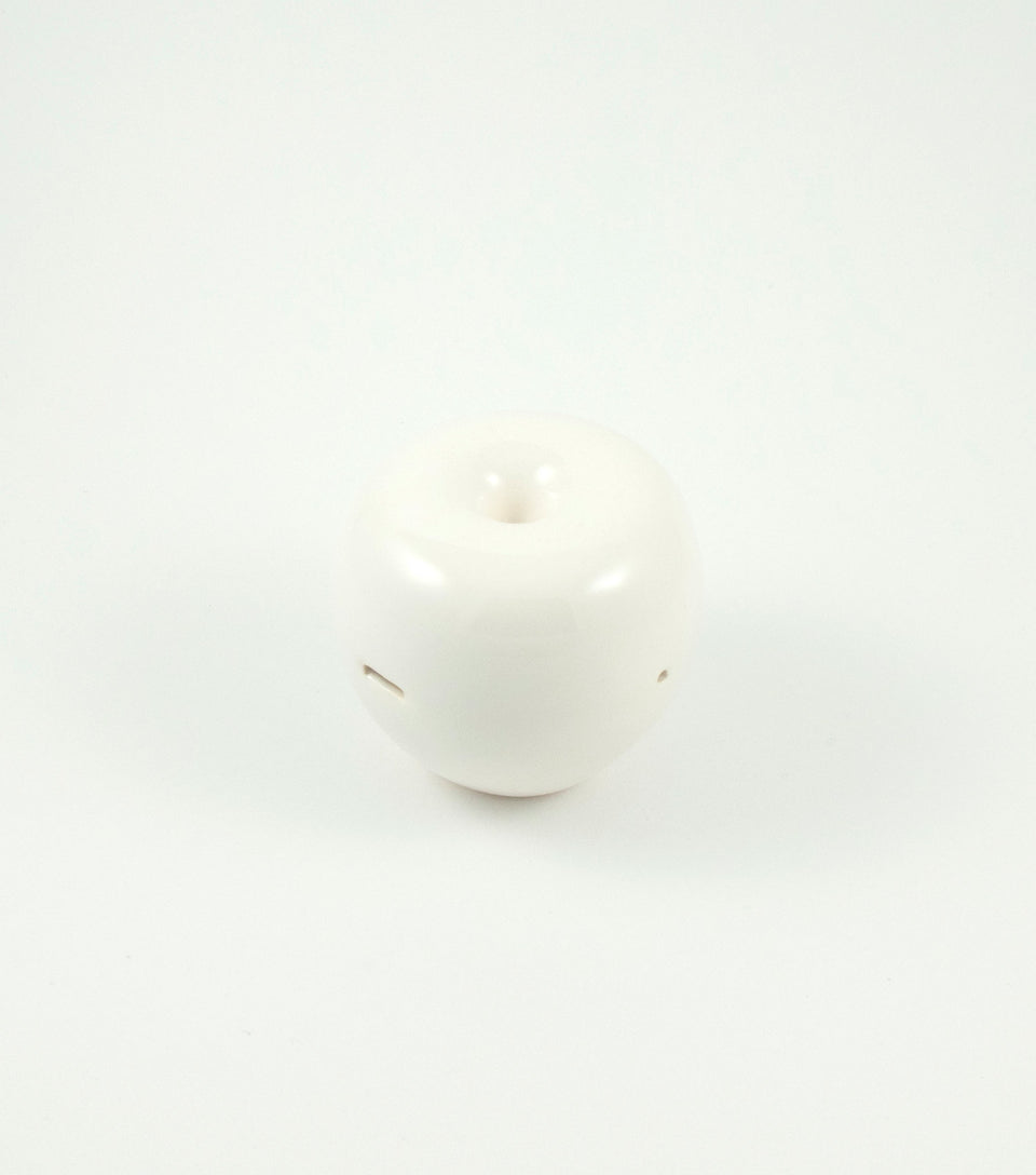 White ceramic cannabis pipe in the shape of an apple.
