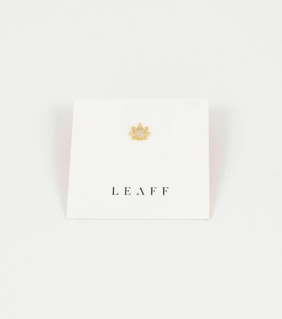 Single weed leaf gold stud.