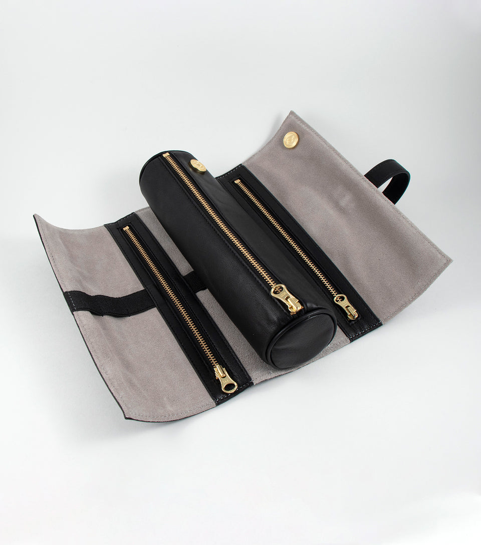Leather and suede cannabis accessories storage bag.