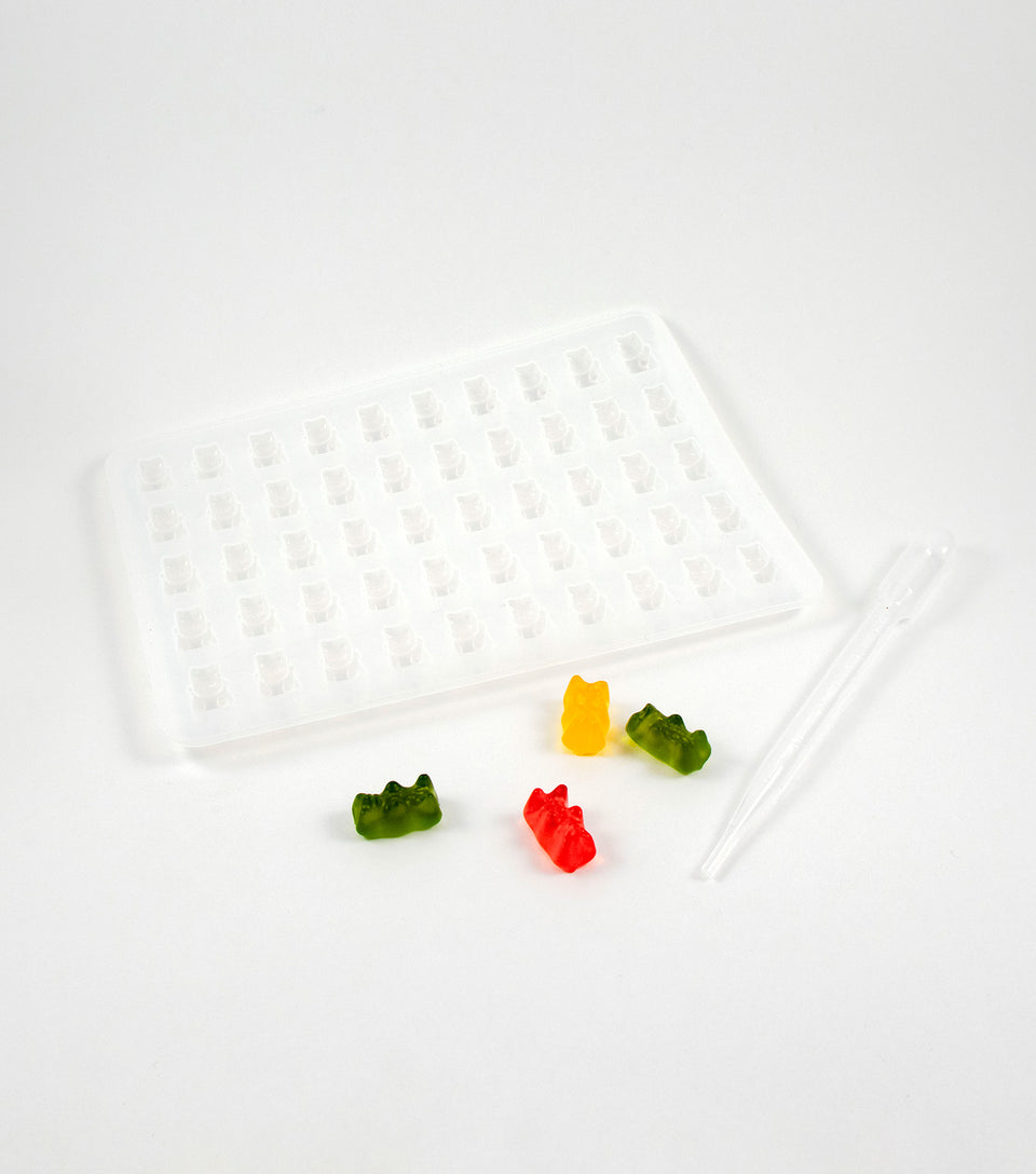 Clear silicone gummy bear mold with dropper.