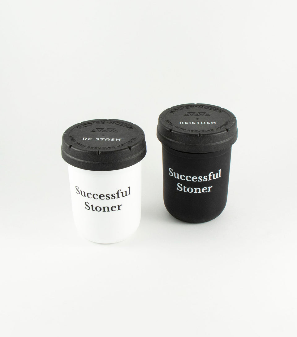 Black and white cannabis storage jars with Successful Stoner writing.