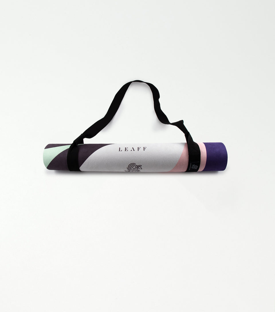 Rolled up yoga mat with carry strap.