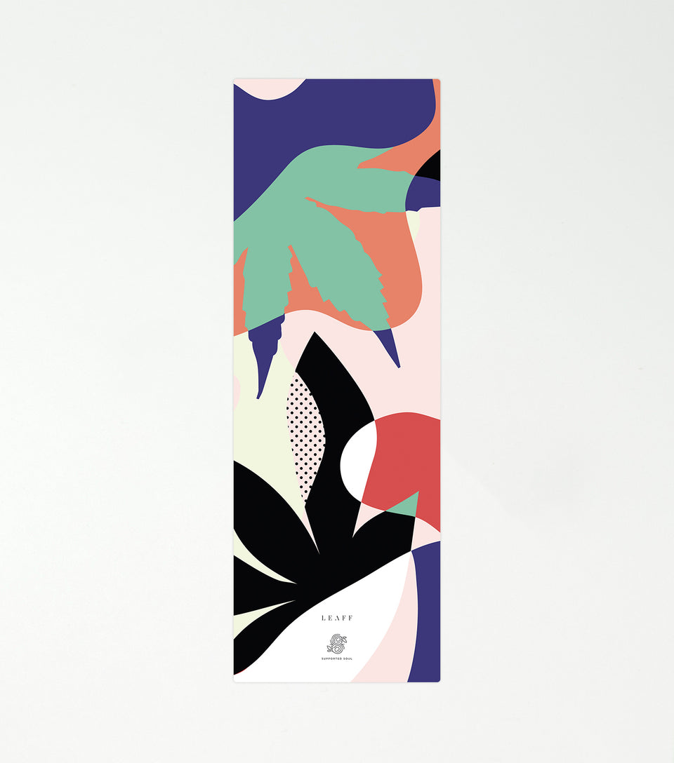 Yoga mat with cannabis leaf design.
