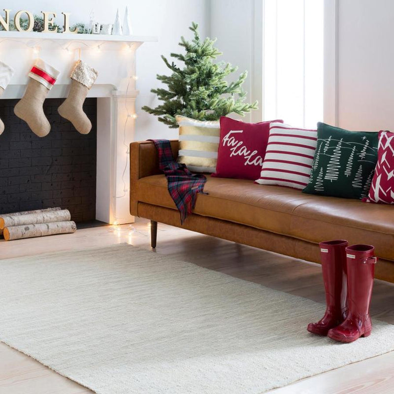 Holiday Decor in a Living Room with a brown leather sofa