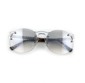 Round sunglasses with clear lens and swirl designed arms. | The Perfect Gentleman