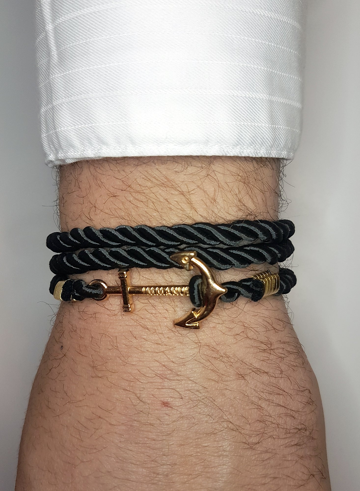 Mens black wrap around bracelet with gold anchor clip | The Perfect Gentleman