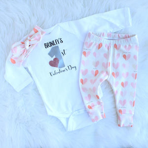 Brinley's 1st valentine's day shirt with matching heart pattern top knot headband and leggings