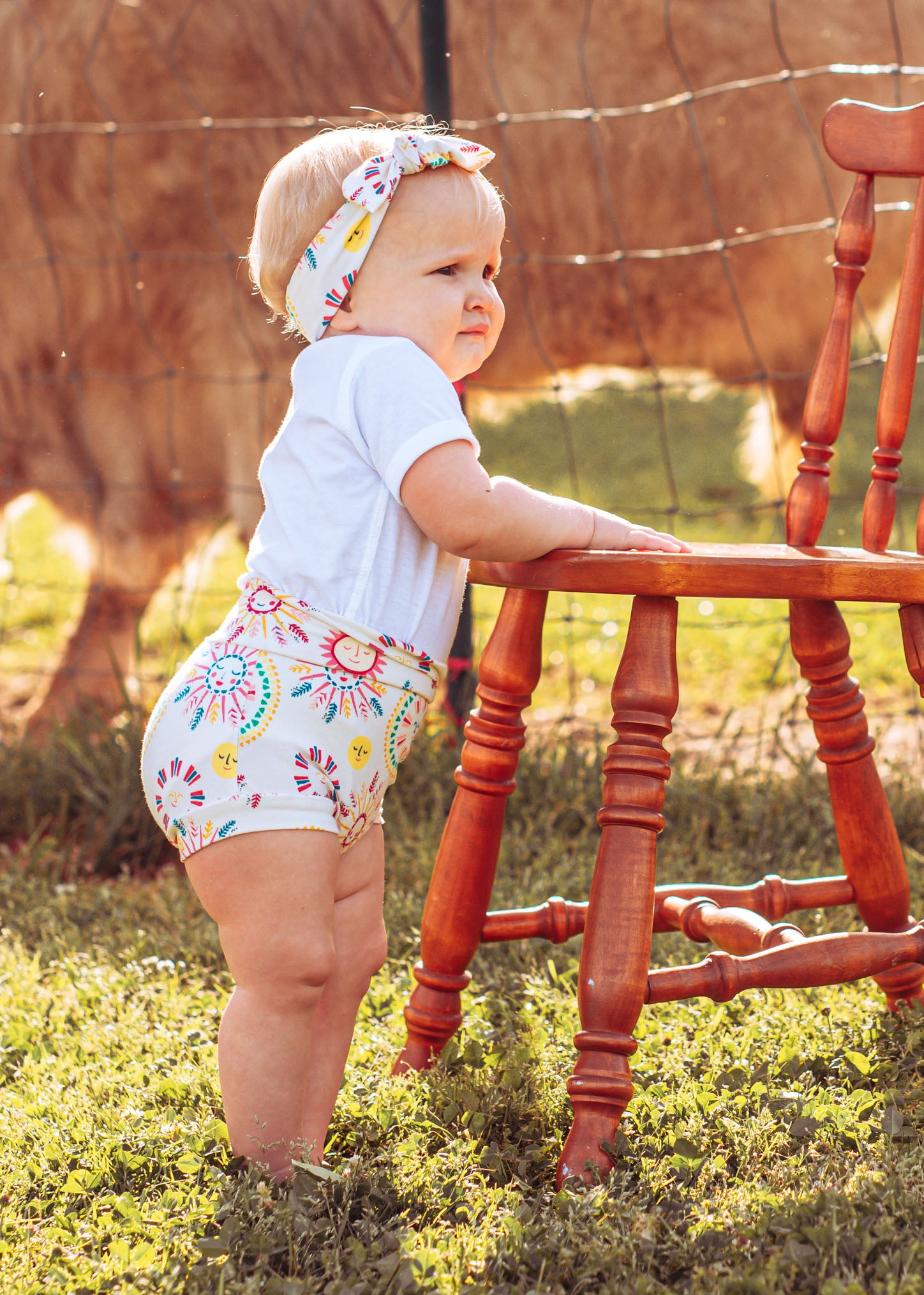 toddler girl wearing a diaper cover with sun print