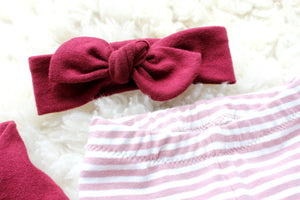 closeup of dark pink top knot headband