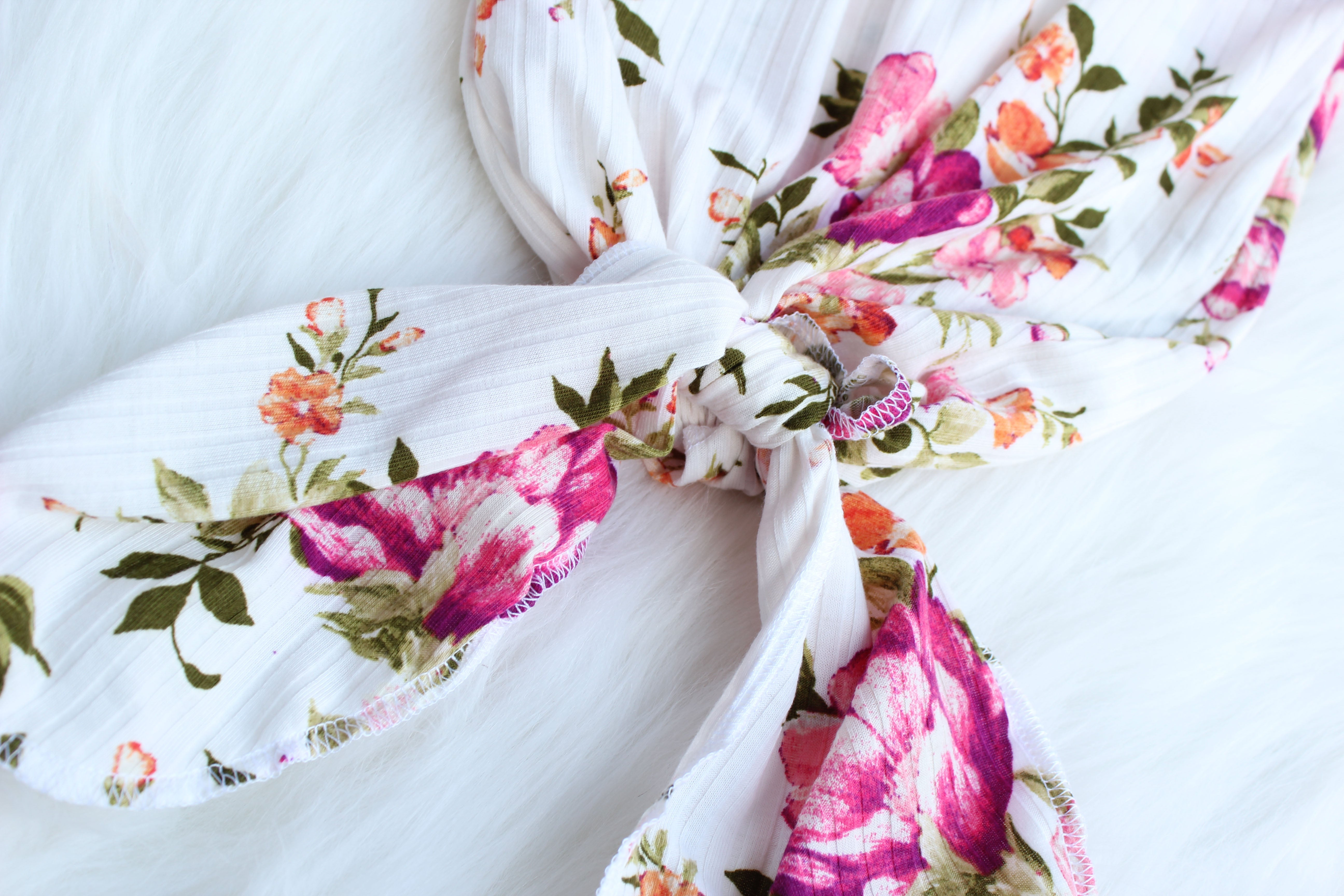 bottom of floral knotted baby gown