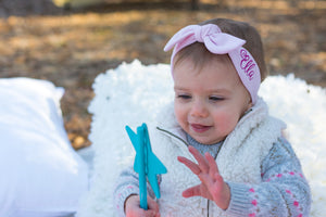 baby girl with blue star wand wearing her personalized pink top knot headband