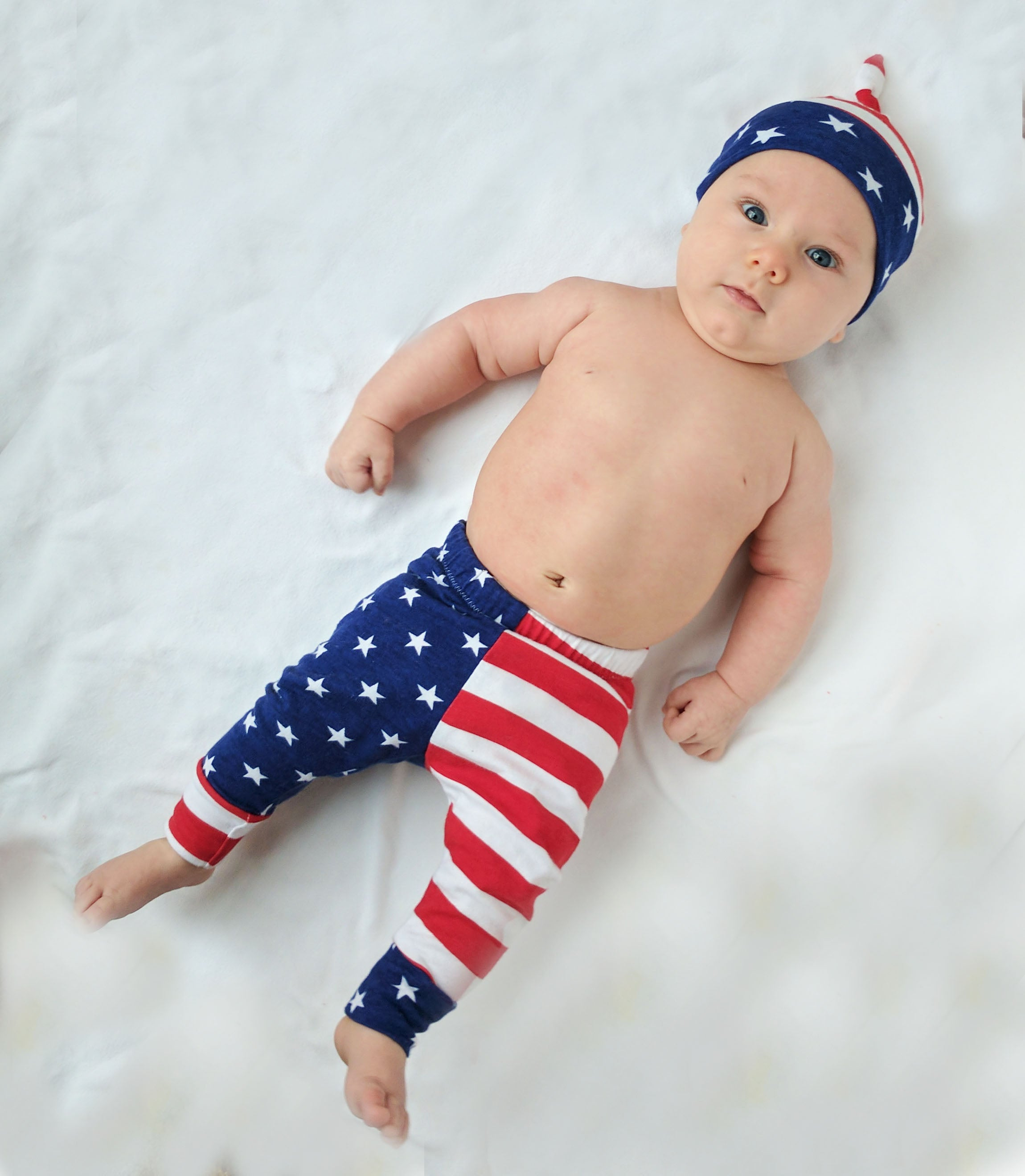 baby boy wearing matching american flag top knot hat and leggings