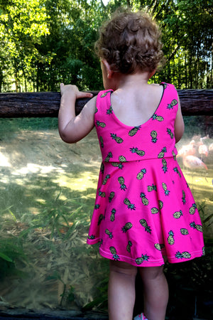 back shot baby wearing pink pineapple print tunic top
