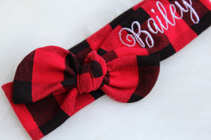 closeup of custom top knot headband in red and black buffalo plaid