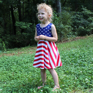 girl wearing patriotic red white and blue sleeveless summer twirl dress