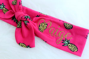 pink pineapple headband with name embroidered in gold thread