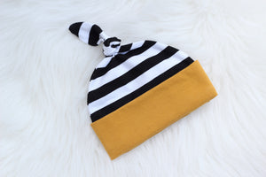 black and white with mustard baby hat