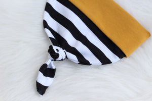 top knot infant hat with black and white and mustard