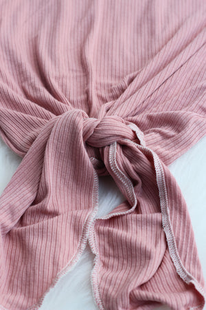 bottom of knotted newborn gown in mauve pink