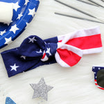 red white and blue flat lay with stars and striped knotted headband