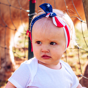 toddler girl wearing american flag top knot headband