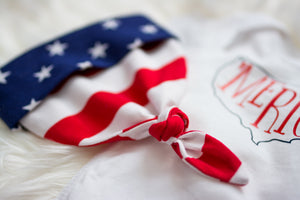 details of american flag top knot hat