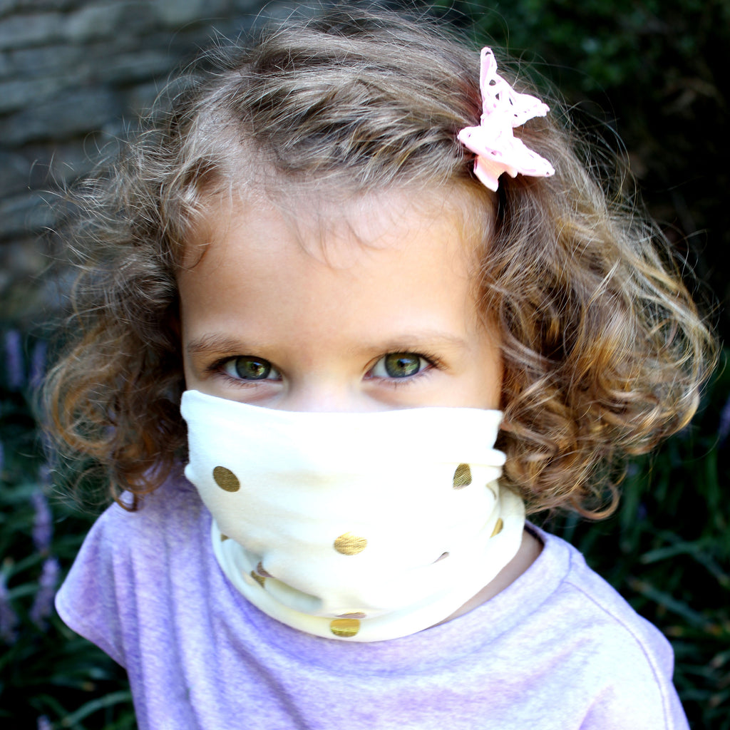 buff style face mask in gold dots on toddler girl