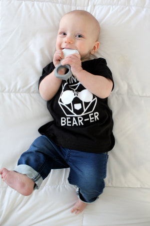 baby chewing on ring teether in black ring bearer tshirt