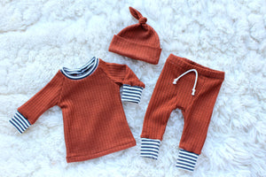 rust orange waffle knit outfit for baby boy coming home outfit