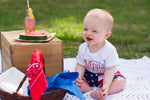 baby boy laughing wearing merica bodysuit and american flag shorts