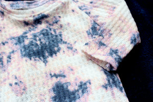 closeup of thermal baby girl pajamas in tie dye print