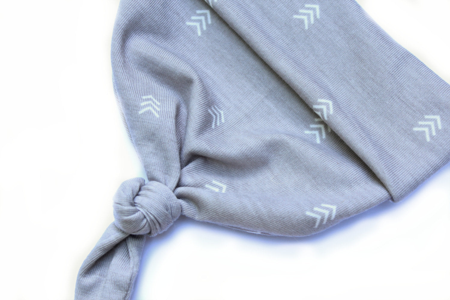 detail shot of grey chevron top knot hat