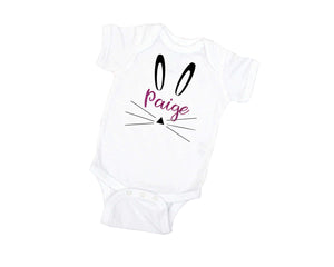 White bodysuit with pink glitter name Paige and bunny face