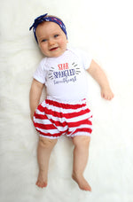 "baby girl modeling ""star spangled sweetheart"" outfit in red white and blue"