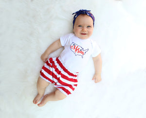 baby girl in 4th of july outfit with sparkly merica bodysuit and red striped bloomers