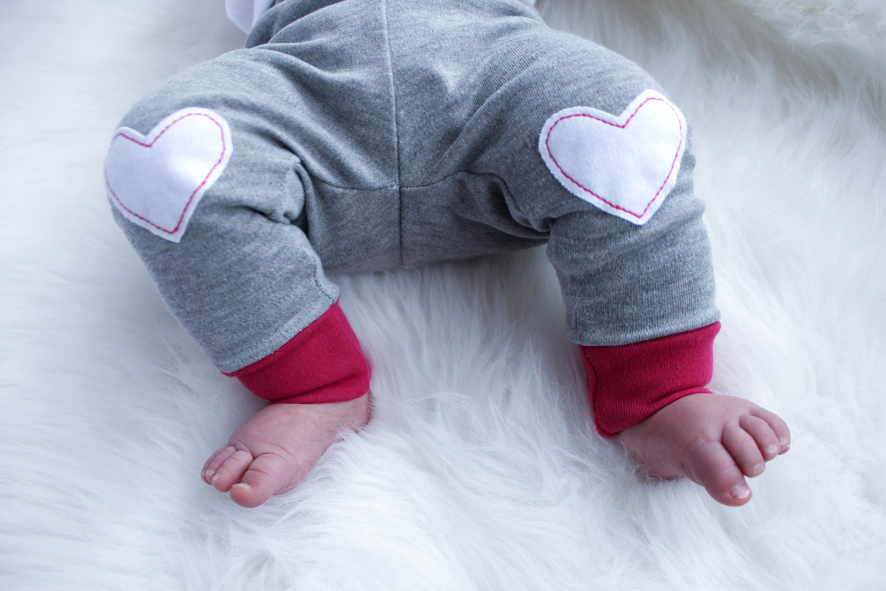 Details of leggings with heart shaped applique