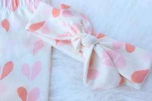 closeup of top knot headband with hearts