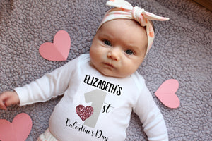 Baby girl wearing a valentine's day shirt with her name on it