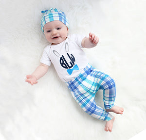 Child modeling monogram bunny Easter blue plaid set for baby boy with leggings top knot hat and white bodysuit