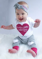 "Little girl sitting and wearing a ""Daddy's Little Valentine"" bodysuit with matching leggings and headbands"