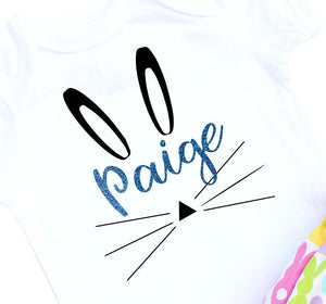 White bodysuit with turquoise glitter name Paige and bunny face