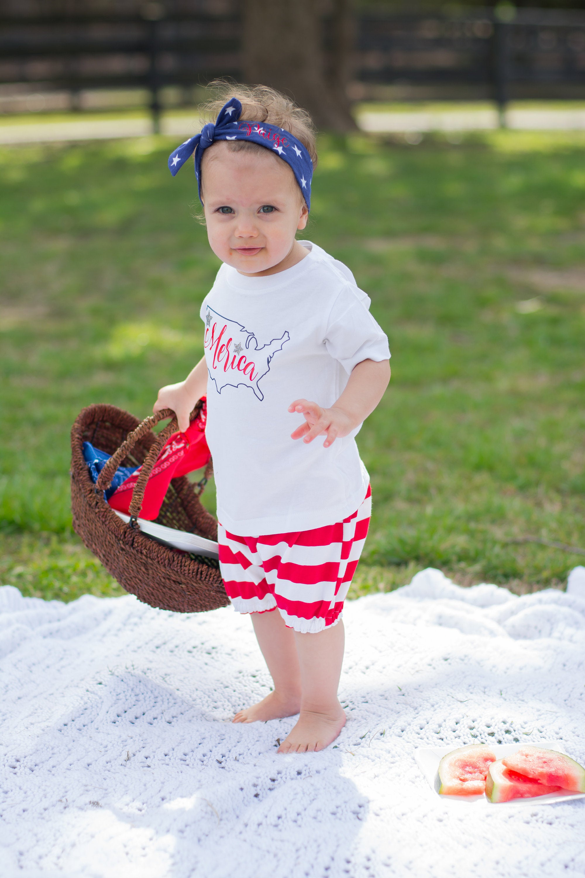 Girl at Memorial Day picnic wearing red white and blue outfit with Merica tshirt