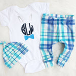 Monogram bunny white bodysuit with plaid leggings and top knot hat