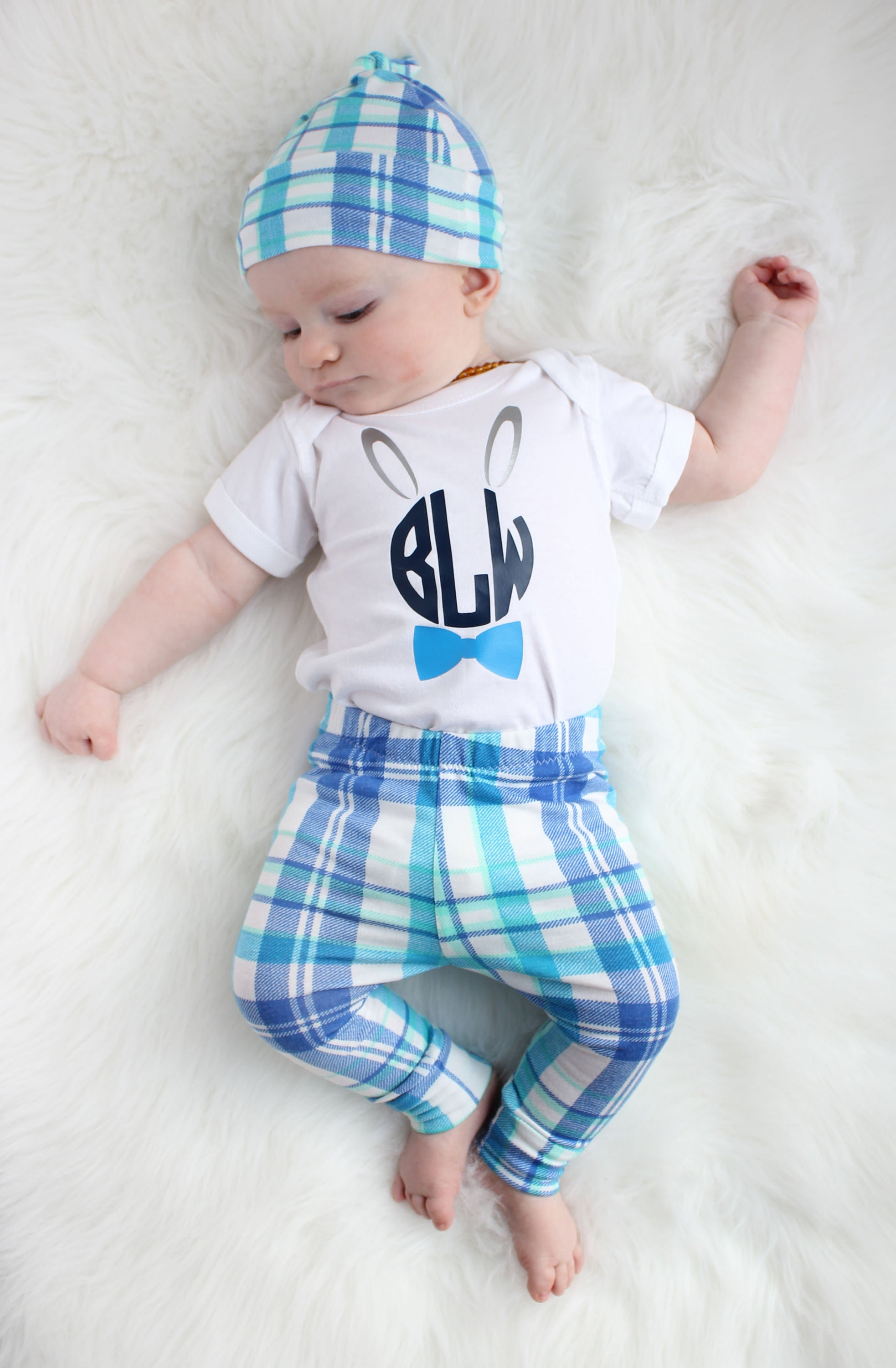 Child modeling Easter blue plaid set for baby boy with leggings top knot hat and monogram bunny white bodysuit
