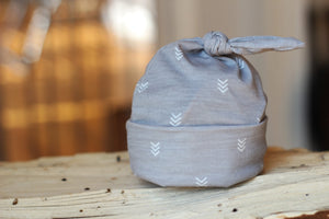 styled photo of gray top knot chevron hat