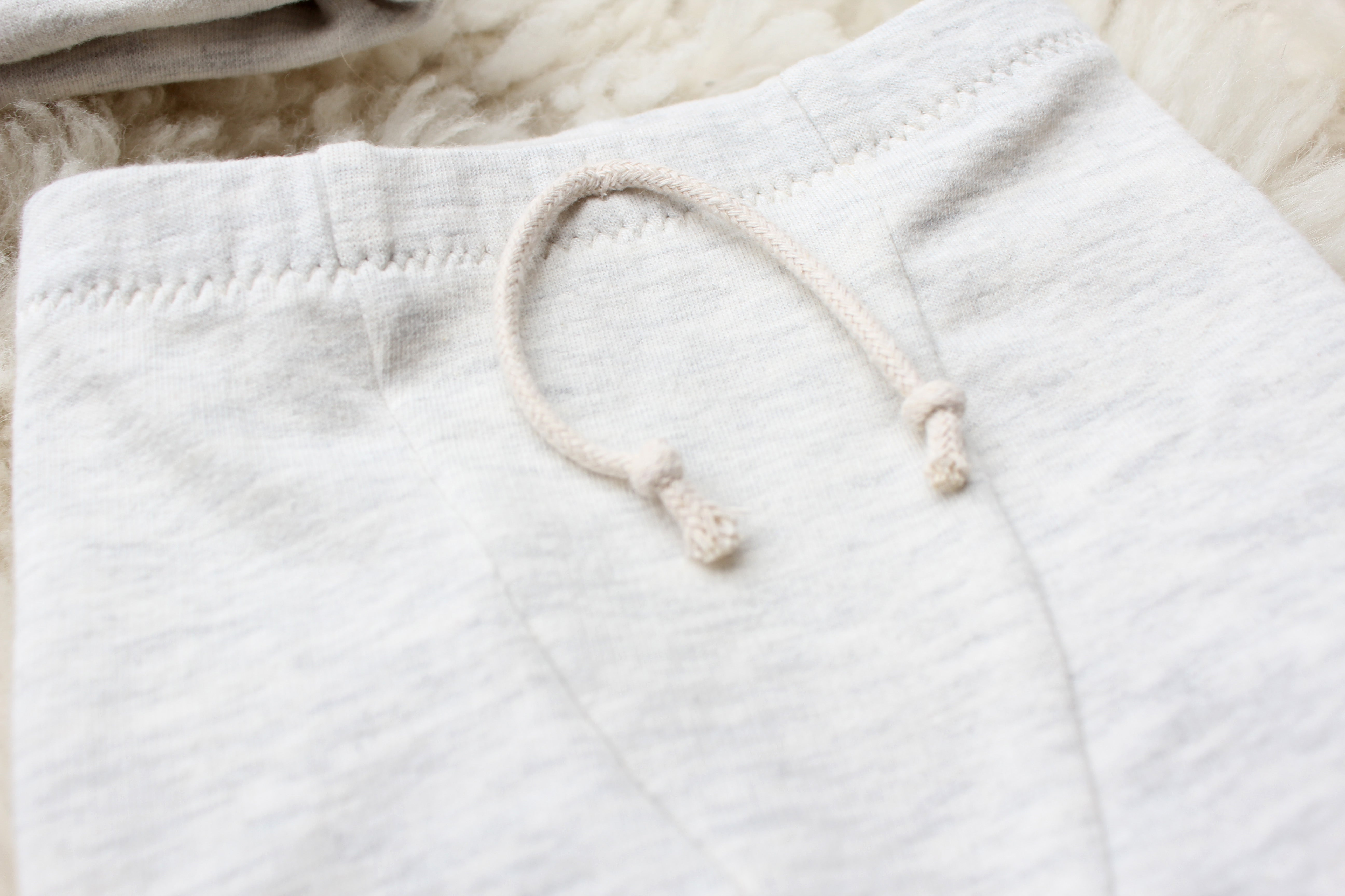 closeup of faux drawstring on baby joggers