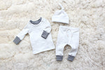 baby boy shirt hat and pant set with striped cuffs in cream