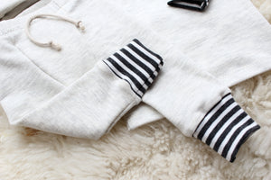 dark grey striped cuffs on cream sweat pants for baby boy
