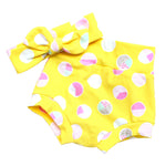 yellow baby bummie shorts and top knot headband with pink and mint polka dots